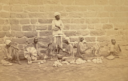 Male prisoners winding cotton on spinning wheels in Karachi Prison